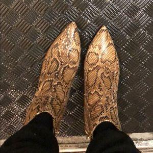 Like-new Steven snake skin booties